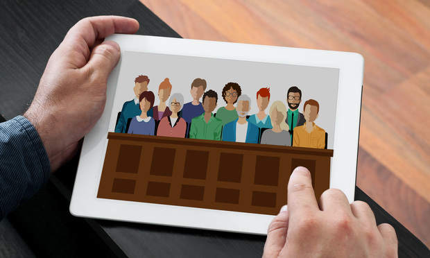 Man holding photo of jurors on a tablet. Photo: Shutterstock.com.