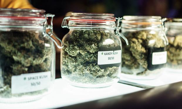 Vending jars of cannabis at a dispensary.