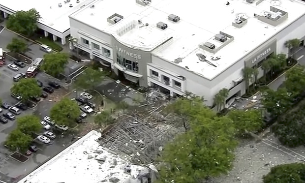 This image taken from video provided by WPLG shows debris covering the parking lot of a shopping center after an explosion on Saturday, July 6, 2019 in Plantation, Fla. The explosion happened Saturday morning at the shopping center, west of Fort Lauderdale in Broward County. The blast sent large pieces of debris about 100 yards (about 91 meters) across the street. (WPLG via AP) MANDATORY CREDIT