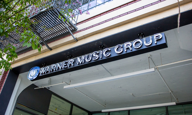 A building front sign for the record label known as Warner Music Group in Los Angeles, California.