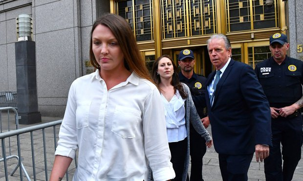 Courtney Wild, left, and Michelle Licata, center, alleged victims of Jeffrey Epstein, exit federal court in New York, U.S., on Monday, July 8, 2019. Epstein used his wealth and power to sexually abuse dozens of young girls for years at one of the biggest mansions in Manhattan, paying them hundreds of dollars in cash for each encounter and hundreds more if they brought in more victims, U.S. prosecutors said. Photo: Louis Lanzano/Bloomberg