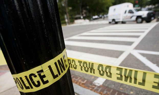Police line tape lines a crime scene in Washington, D.C.  Photo: Diego M. Radzinschi/ALM