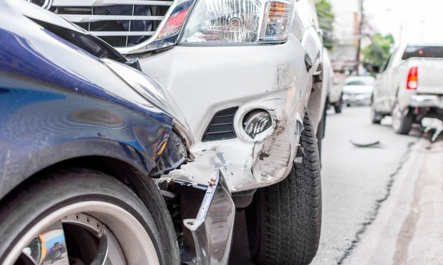 Two cars that have crashed head-on. Photo: PongMoji/Shutterstock.com.