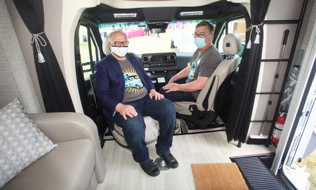Greenberg Traurig Executive Chairman Richard A. Rosenbaum, left, and Chief Executive Officer Brian L. Duffy relax at the helm of the used RV they'll drive during the Mel on Wheels Getting Together Tour. The tour kicked off April 10, 2021 at Tropical Park Equestrian Center in Miami, FL.. The RV is nicknamed Mel in honor of Mel Greenberg, one of three founders of the Miami-founded global law firm Greenberg Traurig. The tour will travel to GT offices throughout Florida, and out of state, to reconnect with employees of the law firm's 30 U.S. offices and to make donations at each tour stop to a local food bank or charity. Photo: Marsha Halper
