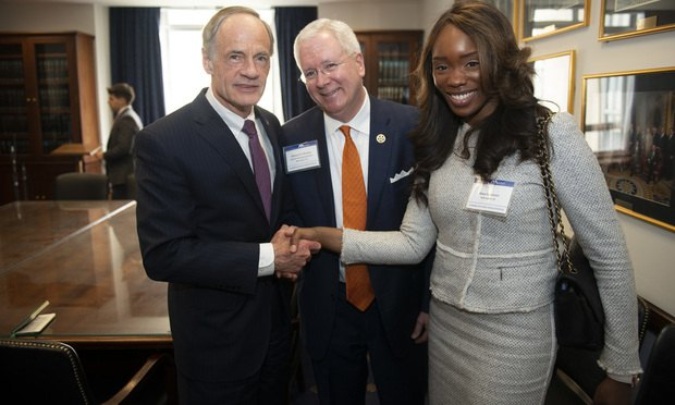 Pictured, from left, are Sen. Thomas Carper, William Johnston from Young Conaway Stargatt & Taylor and Mary Akhimien of Connolly Gallaghe