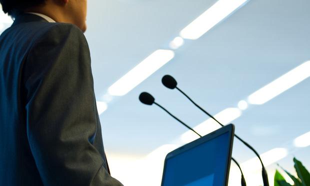 speaker-at-podium speaking, speaker, talking, communication, talk, speech, webinar, labtop, computer, microphone, mic
