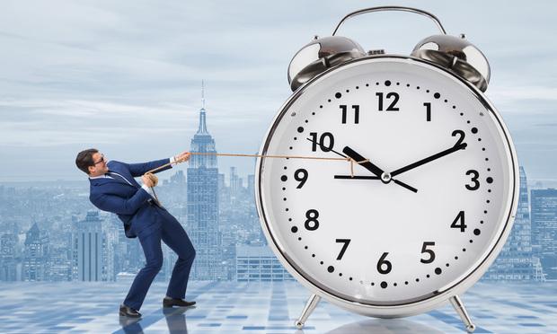 Businessman Pulling Clock