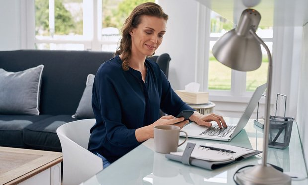 Businesswoman working from home.