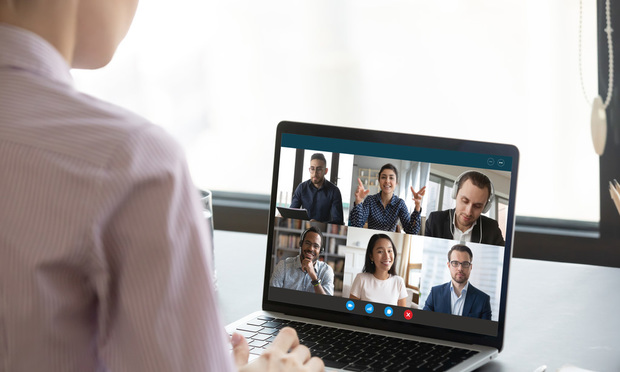 Group on video call with multi-ethnic international colleagues.