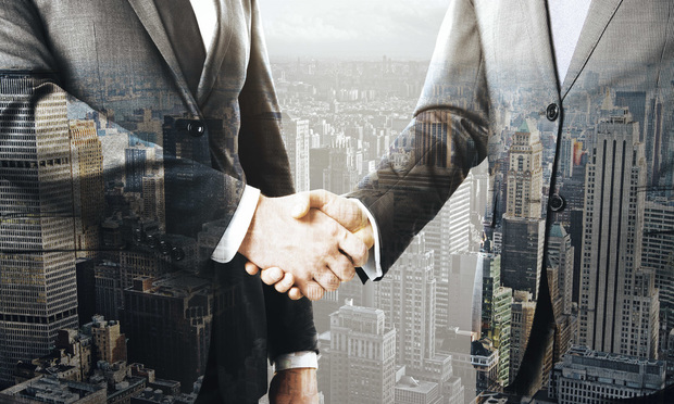 Business people shaking hands on New York city background. Concept of partnership. Double exposure.