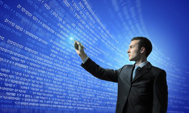 businessman looking at data screen