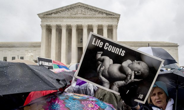 Anti-abortion supporters outside the U.S. Supreme Court in Washington, Tuesday, March 20, 2018. (AP Photo/Andrew Harnik)