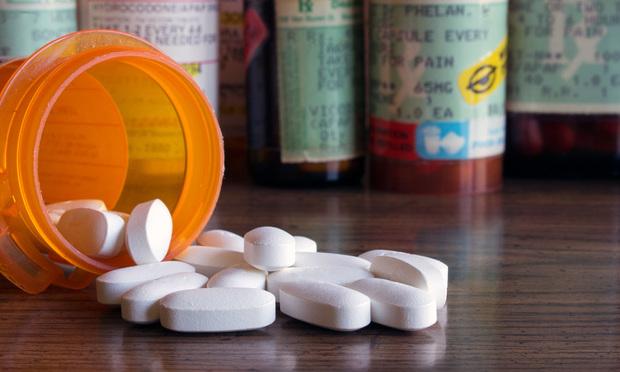 Opioid pills/Credit: Kimberly Boyles/Shutterstock.com