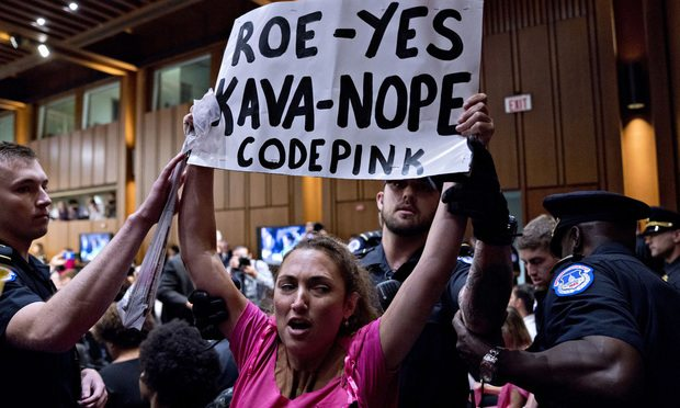 A Codepink demonstrator is removed by U.S. Capitol police during the Senate Judiciary Committee confirmation hearing Tuesday on Judge Brett Kavanaugh's nomination to the U.S. Supreme Court. (Photo: Andrew Harrer/Bloomberg)