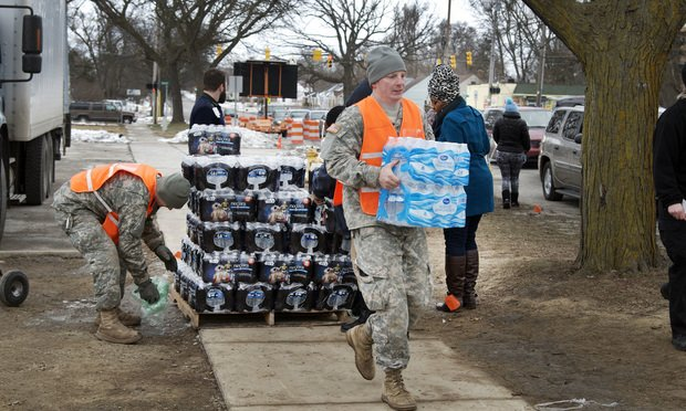 Bottled water distribution by National Guard at Fire Station No. 6 in downtown Flint, Michigan, Jan. 23, 2016.
