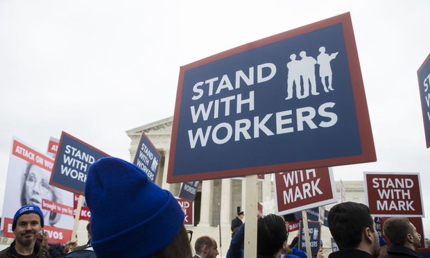 Demonstrators outside the U.S. Supreme Court during arguments in the union fees case Janus v. AFSCME, on February 26, 2018.