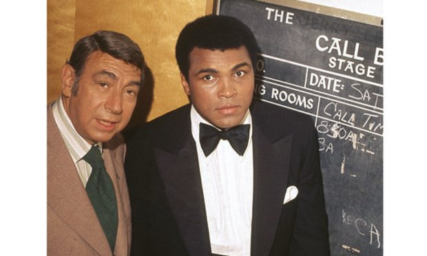"Muhammad Ali is photographed with Howard Cosell backstage before ""The Muhammad Ali Variety Special"" in July of 1975. (Photo: Isaac Sutton/Ebony Collection/Johnson Publishing Company)"