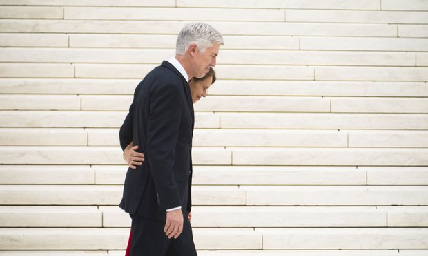Associate U.S. Supreme Court Justice Neil Gorsuch, right, hugs his wife Louise on the steps of the U.S. Supreme Court after his Investiture ceremony, on June 15, 2017.