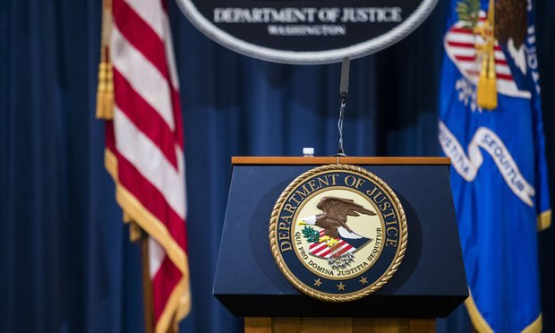 Department of Justice Sign Article 202001151420.'