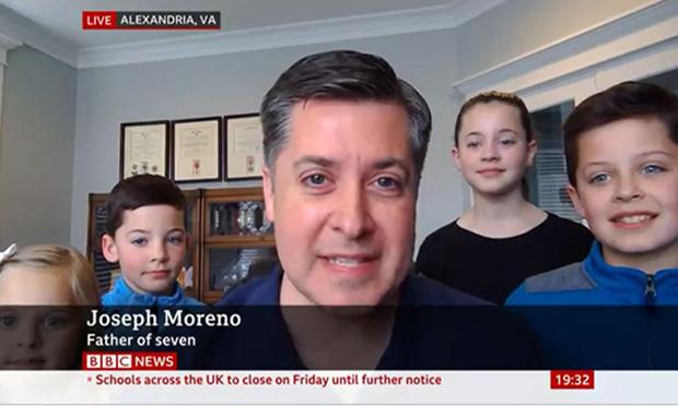 Joseph Merino with three of his children.