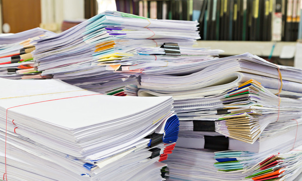 Stack of business documents on desk.