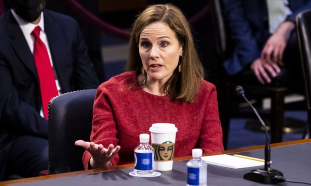 Judge Amy Coney Barrett, President Trump's nominee to be Associate Justice at the U.S. Supreme Court, testifies before the Senate Judiciary Committee during her confirmation hearing in Washington.