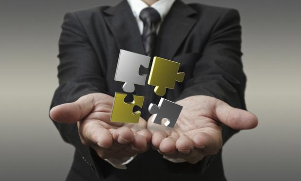 puzzle pieces hands business