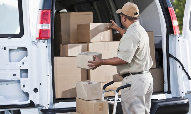 man delivering packages box truck delivery