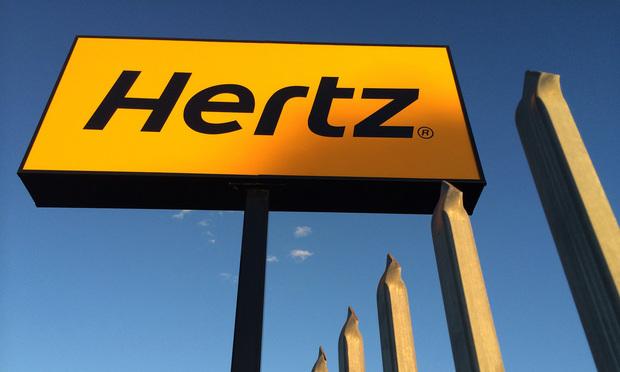 Hertz rental sign/photo by enjosmith/Flickr