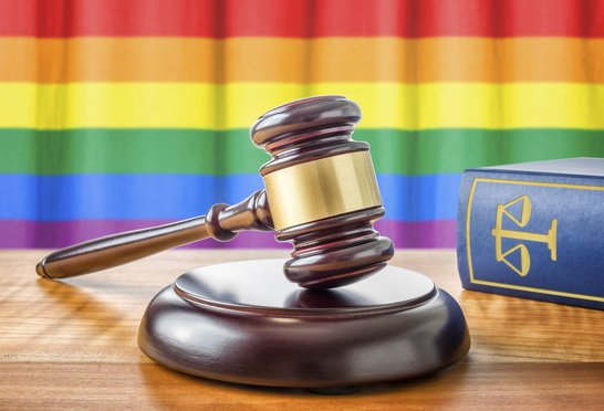 rainbow flag, gavel, law book
