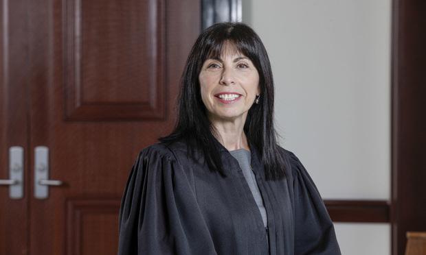 Judge Freda Wolfson.