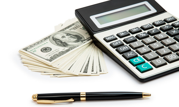 Money, calculator and pen. Photo by BigStock.