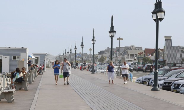 People walking on the boardwalk Belmar/Credit: NTL Photography/Shutterstock.com