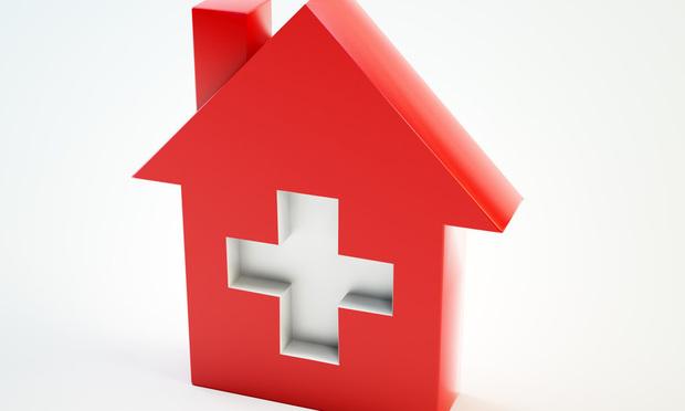 Domestic healthcare symbol - Mopic/Shutterstock.com