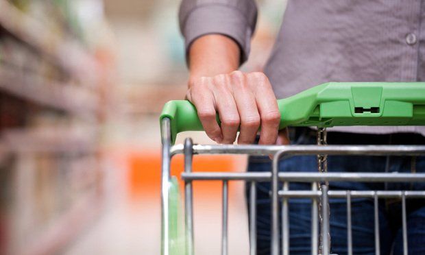shopping cart and shopper - Kzenon/Shutterstock