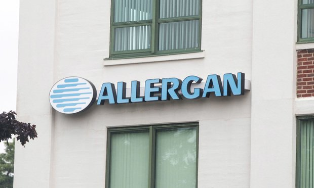 Allergan Plc. signage is displayed on the exterior of the company's office in Medford, Massachusetts, U.S., on Tuesday, June 25, 2019. Photographer: Scott Eisen/Bloomberg