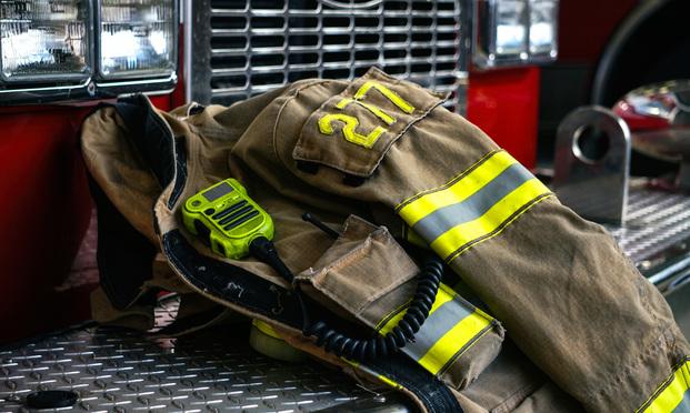 Firefighter coat on the fire truck - Image. shutterstock