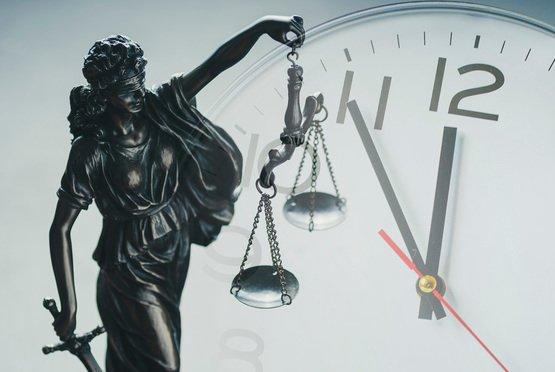 scales of justice with clock