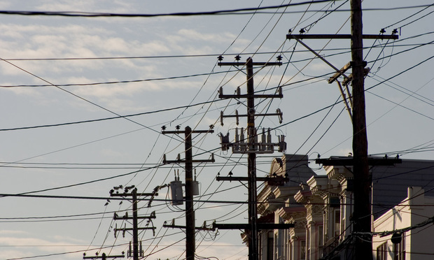 Utility poles and wires/photo by Aaron Kohr/Shutterstock