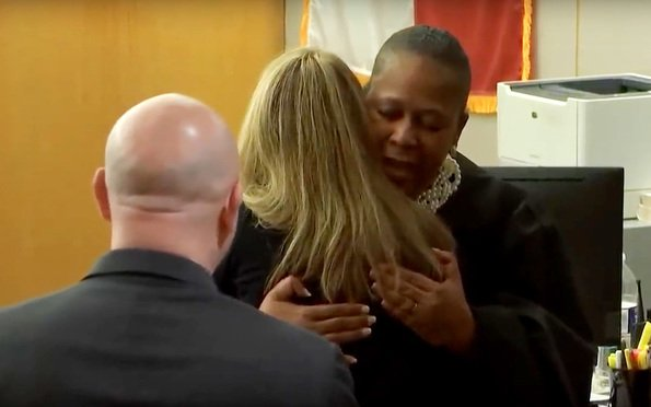 Judge Tammy Kemp gives Amber Guyger her personal Bible and a hug. Image via WFFA Video/YouTube