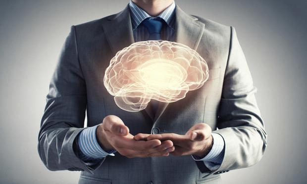 business man holding brain