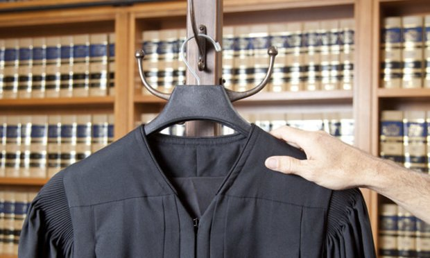 Hand and judicial robe photo illustration