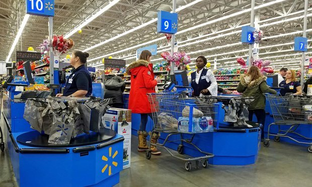 Walmart shoppers checking out