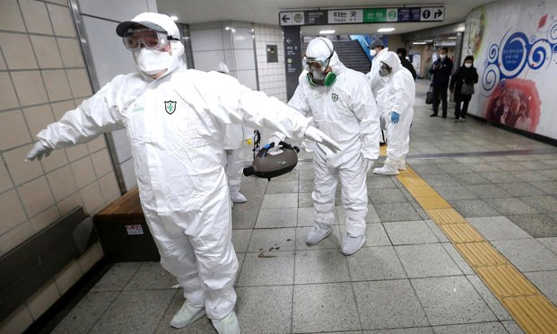men in protective suits from coronavirus