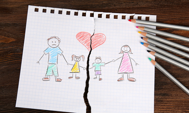 drawing of family of four that is torn in two