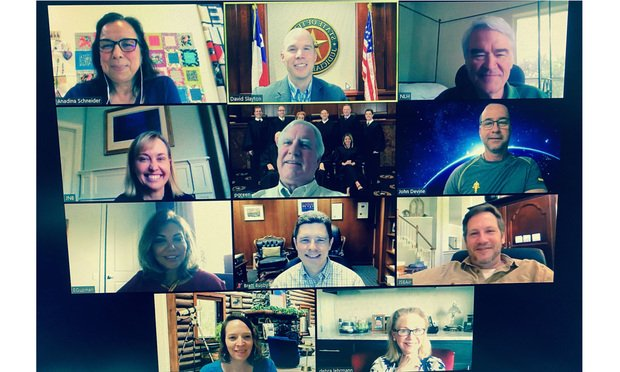Texas Supreme Court justices hold a court conference through Zoom on March 27.