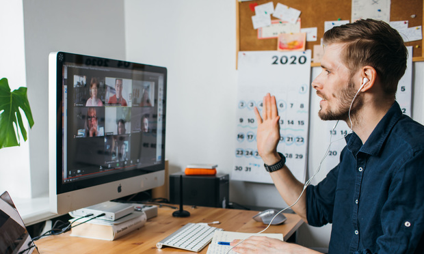 man participates in Zoom video conference
