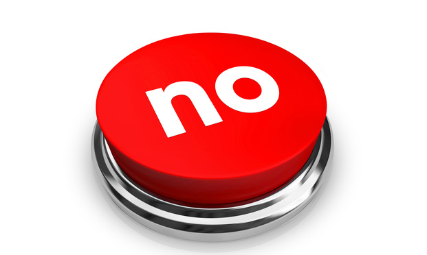a red button with word 'no' on it