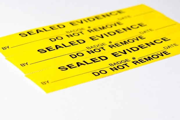 """yellow tag that says """"sealed evidence. do not remove"""""""