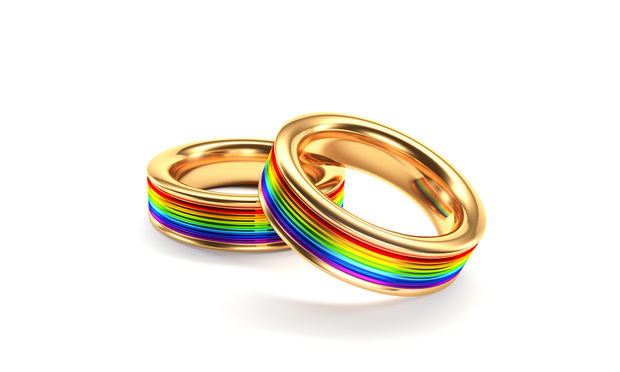 two wedding bands decorated with rainbows